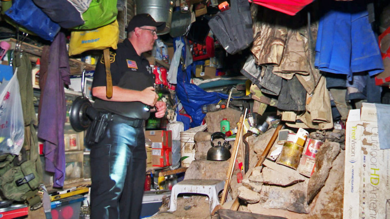 Authorities investigate a makeshift bunker in the township of Ringle, Wis.