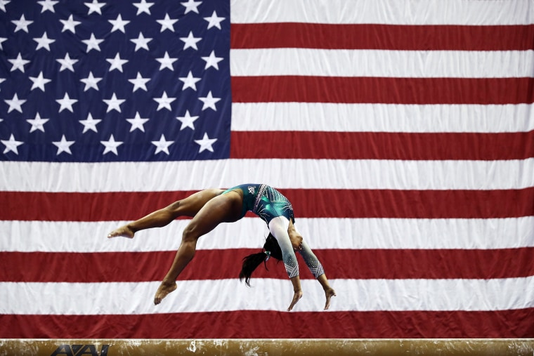 Simone Biles competes on the balance beam during the Senior Women's competition at the U.S. Gymnastics Championships in Kansas City, Missouri, on Aug. 9, 2019.