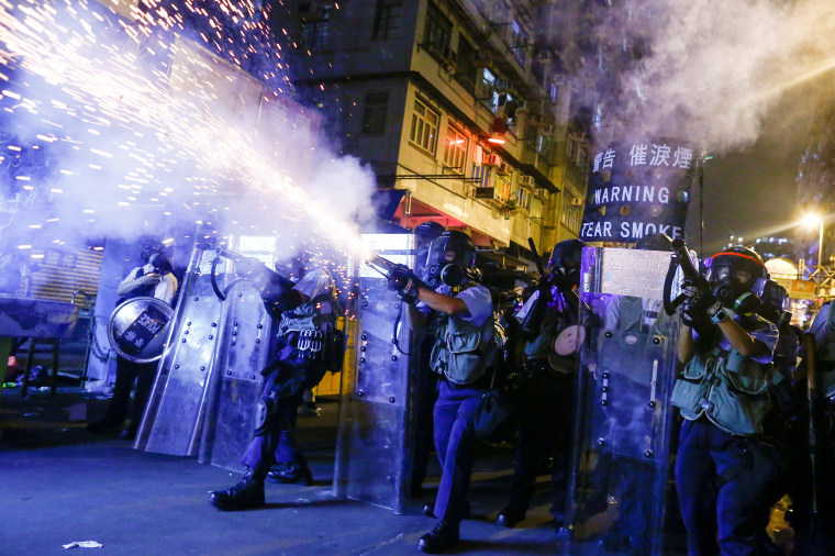 Police fire tear gas at anti-extradition bill protesters during clashes in Sham Shui Po in Hong Kong on Aug. 14, 2019.