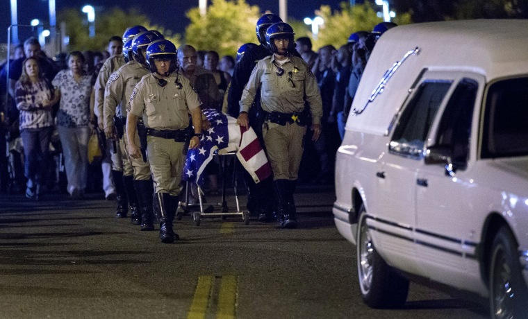 The casket of slain CHP officer Andre Moye is transported to a hearse from the Riverside University Health Systems Medical Center in Riverside in Moreno Valley, Calif., on Aug 12, 2019. Moye was shot and killed while two fellow officers were wounded during a traffic stop.