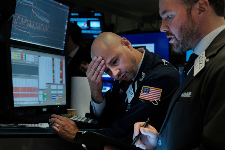 Traders work on the floor of the New York Stock Exchange on Aug. 14, 2019. Following news of an economic slowdown in both Germany and China, concerns over a recession in America sent stocks plummeting with the Dow down over 800 points.