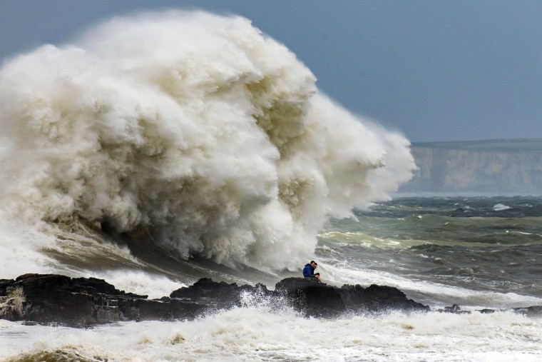 Waves crash against the harbor wall in Porthcawl, Wales. on Aug. 10, 2019.  The Met Office have issued a yellow weather warnings for winds of up to 60mph and thunderstorms for large parts of the U.K.