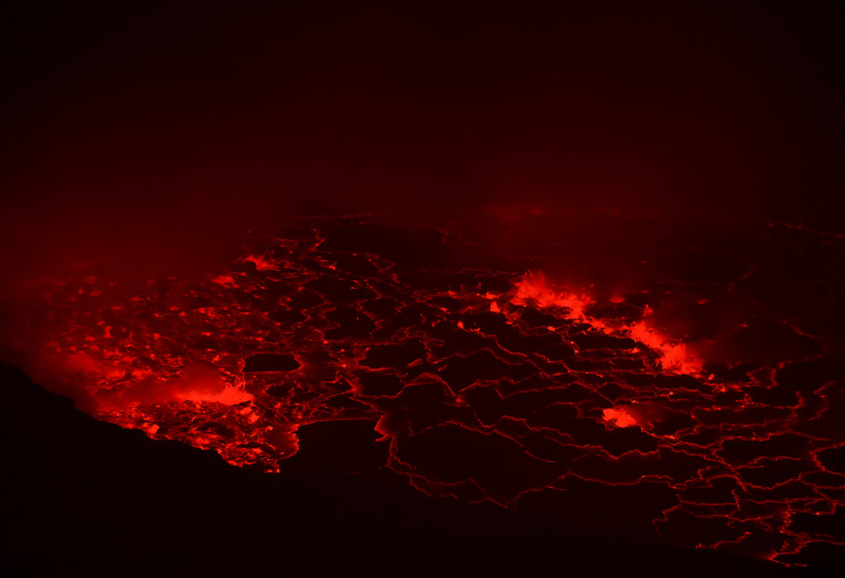 Lava glows inside the crater of the Nyiragongo volcano inside the Virunga National Park in the Democratic Republic of Congo on Aug. 9, 2019.
