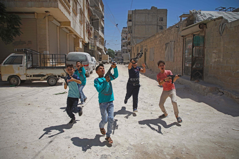 Boys play with plastic guns on the first day of the Muslim religious festival of Eid al-Adha in al-Dana in Syria's rebel-controlled Idlib region, near the border with Turkey, on Aug. 11, 2019.