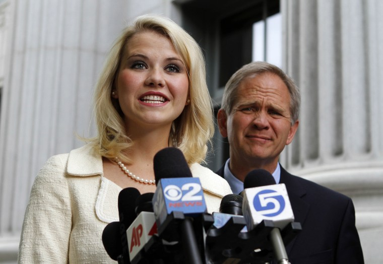 Image: Elizabeth Smart, left, and her father Ed Smart talk to the media in front of the Frank E. Moss Federal Courthouse.