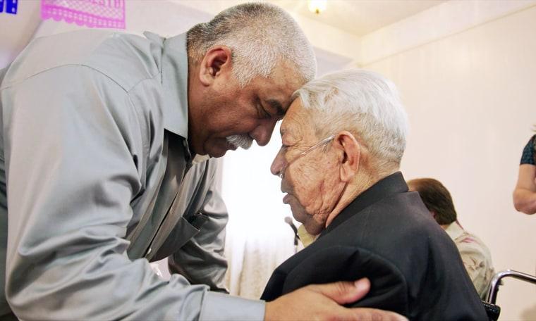 "A relative hugs Guadalupe Cuevas at his living wake in HBO's documentary ""Alternate Endings."""