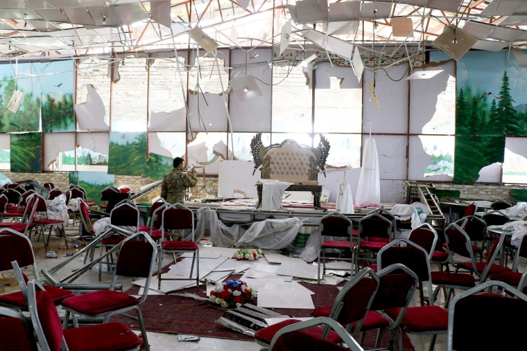 Image: Afghan security officials inspect the scene after a suicide bomb blast at a wedding reception in Kabul, Afghanistan, on Aug. 18, 2019.
