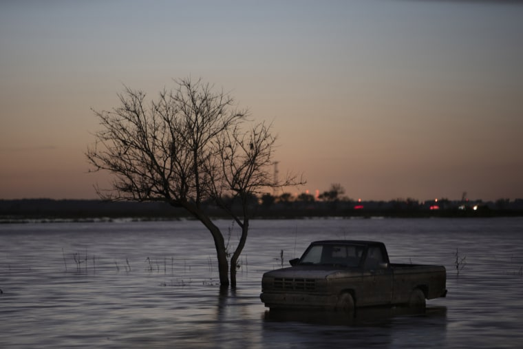 Image: A pickup truck near Bartlett, Iowa, remains submerged on August 14, 2019, by floodwaters from the Missouri River that overtook small towns and farmland in the Midwest more than five months ago.