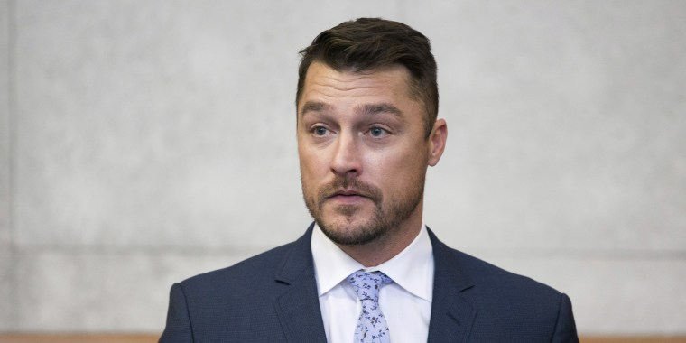 "Reality TV star Chris Soules, of ""The Bachelor,"" left, gets up to leave the courtroom after his sentencing was delayed, Tuesday, May 21, 2019, in Independence, Iowa. Soules pleaded guilty to a misdemeanor for leaving the scene after rear-ending a slow-moving tractor driven by farmer Kenneth Mosher. (Kelly Wenzel/The Courier via AP, Pool)"