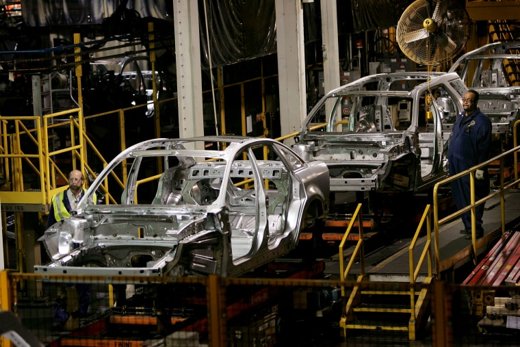 Image: Workers build Ford vehicles at the Torrence Avenue Assembly Plant in Chicago in 2007.