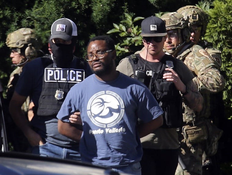 Image: Salt Lake City police take Ayoola Ajayi into custody in connection with missing University of Utah student MacKenzie Lueck