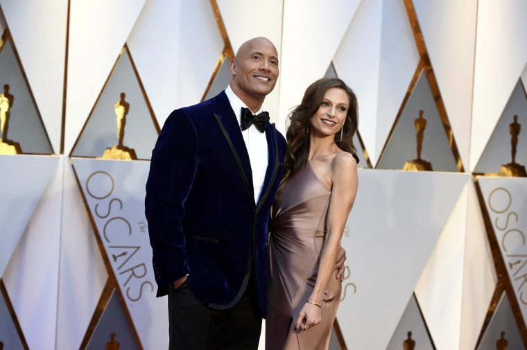 Image: Dwayne Johnson and Lauren Hashian arrive at the Oscars in Los Angeles on Feb. 26, 2017.