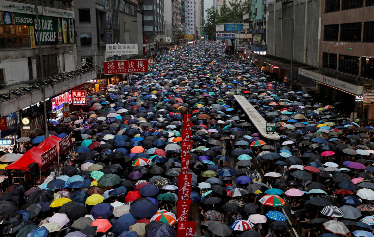 Image: People march during a rally to demand democracy and political reforms in Hong Kong