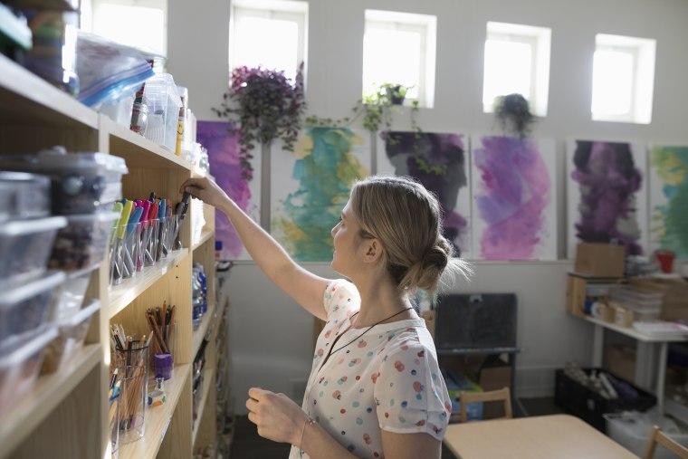 Preschool teacher cleaning classroom