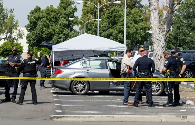 Image: Police investigate the scene where a Cal State Fullerton administrator was fatally stabbed in Fullerton, Calif., on Aug. 19, 2019.
