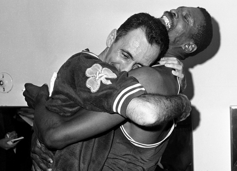 Image: Bob Cousy and Bill Russell share a hug after winning the Boston Celtics' fifth consecutive NBA Championship after defeating the Los Angeles Lakes in 1963.