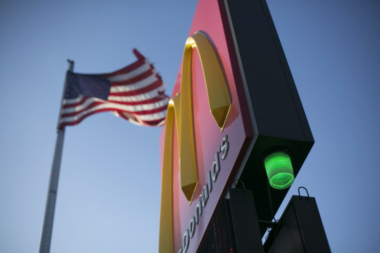 Image: A green light is illuminated on a McDonalds in Detroit