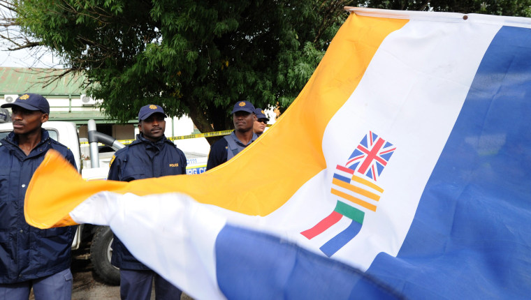 Image: South Africans supporting the white supremacist Afrikaner Resistance Movement fly the apartheid era flag.