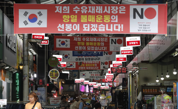 Image: Banners calling for a boycott of Japanese products are displayed inside the Suyu market in Seoul, South Korea