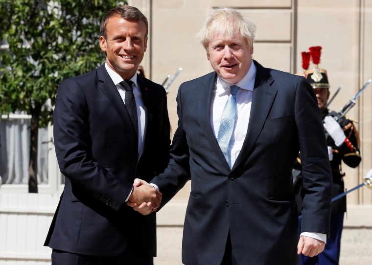 Image: French President Emmanuel Macron welcomes British Prime Minister Boris Johnson before a meeting on Brexit at the Elysee Palace in Paris