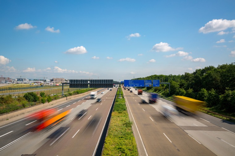 Image: Multilane Autobahn highway with blurred trucks and cars, Germany.