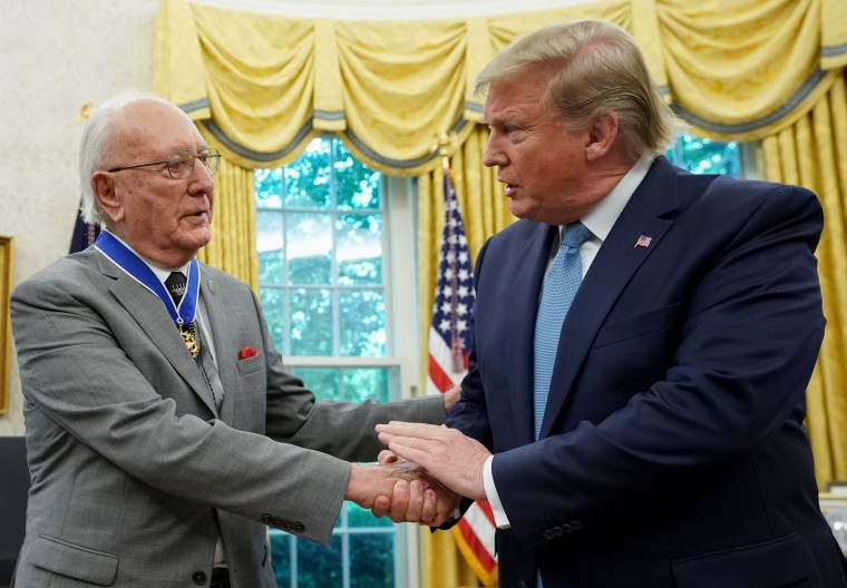 Image: President Donald Trump shakes hands with Celtics basketball legend Bob Cousy after presenting him with the Presidential Medal of Freedom in the Oval Office on Aug. 22, 2019.