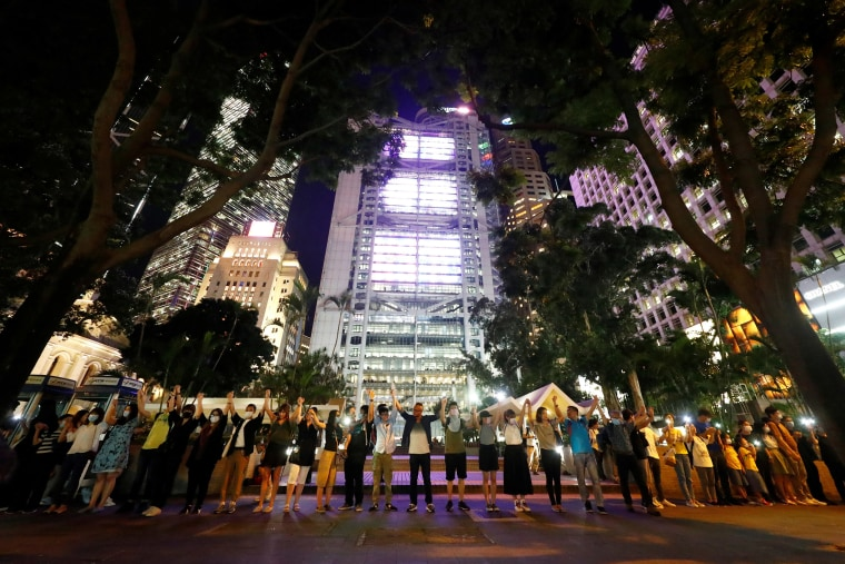 Hong Kong protesters form 28-mile human chain demanding democracy