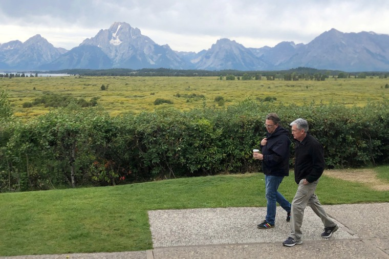 Image: Federal Reserve Chair Jerome Powell and New York Federal Reserve President John Williams walk together in Jackson Hole
