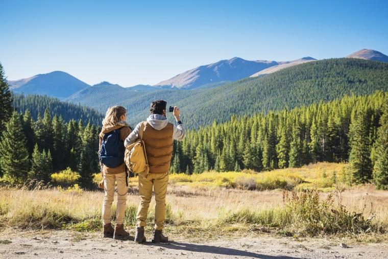 Image: couple photographing mountains, Breckenridge, Colorado