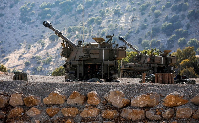 Image: Israeli soldiers sit inside a self-propelled artillery gun near the border with Syria in Golan Heights on Aug. 25, 2019.