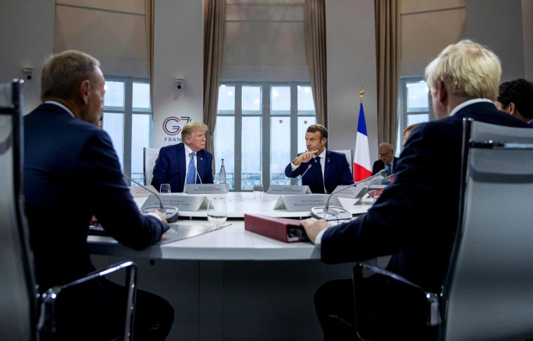 Image: President Donald Trump meets with other world leaders at a working session during the G7 Summit in Biarritz, France, on Aug. 25, 2019.