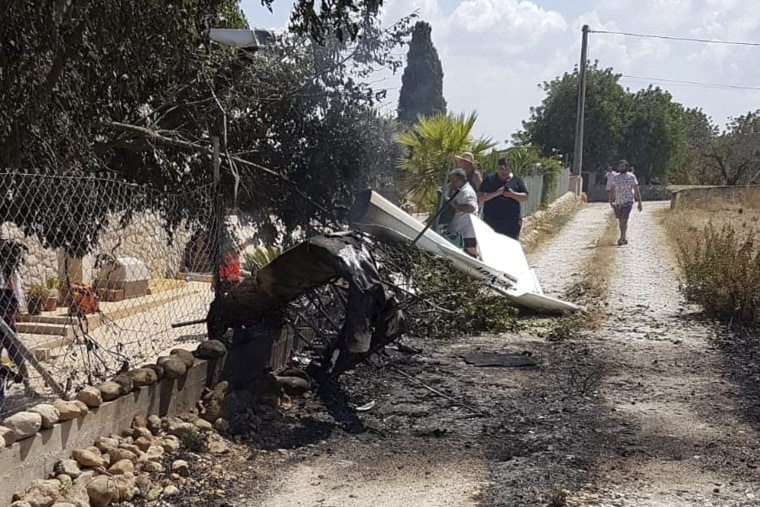 Image: The wreckage after a helicopter and small plane collided in Mallorca, Spain, on Aug. 25, 2019. Authorities say at least five people were killed.