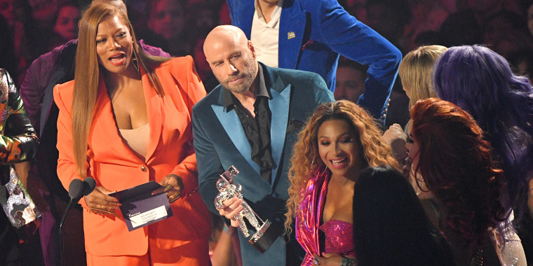John Travolta appears to give award to 'Drag Race' star instead of Taylor Swift at VMAs