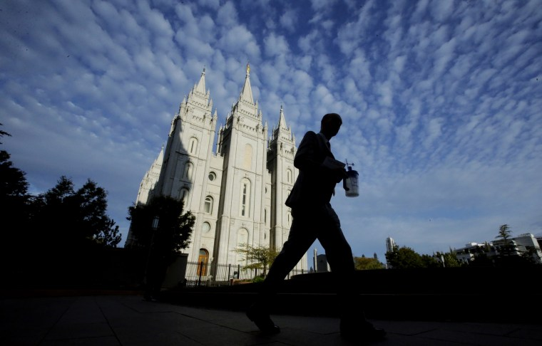 Image: A man walks past The Church of Jesus Christ of Latter-day Saints temple in Salt Lake City, Utah, on Sept. 14, 2016.