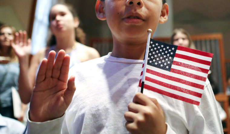 Image: U.S. Citizenship And Immigration Services Hold Naturalization Ceremony For 50 Young People In Los Angeles