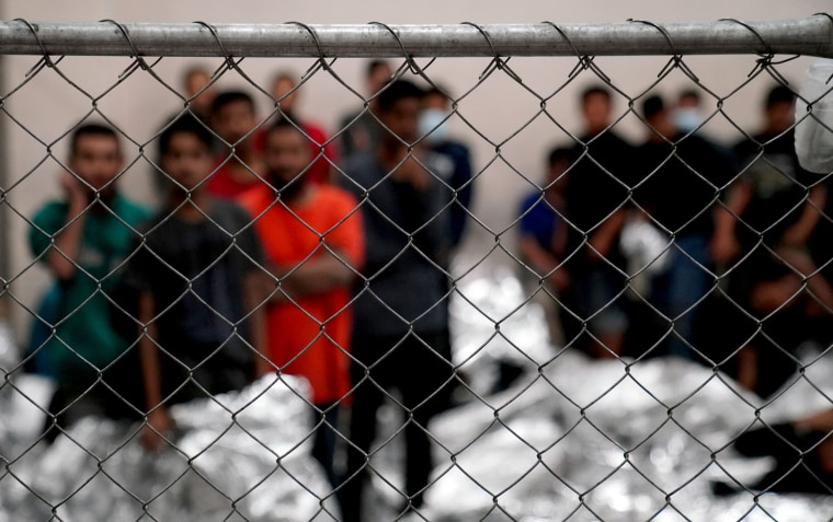 Image: Adult male detainees stand inside a holding area at the Border Patrol station in McAllen, Texas, on July 12, 2019.