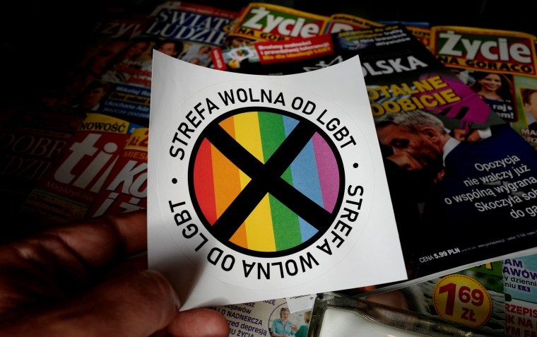 "Image: FILE PHOTO: Sticker with words  ""LGBT-free zone"" distributed in weekly conservative magazine ""Gazeta Polska"" is pictured in Warsaw,"