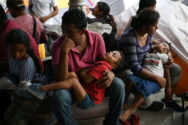 Image: Honduran asylum seekers sent back to Mexico from the U.S. under Migrant Protection Protocols (MPP) pass the time at a makeshift encampment in Matamoros