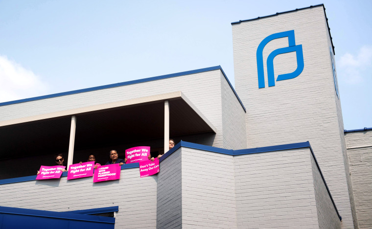 Image: Abortion rights advocates and Planned Parenthood staff hold a rally outside a clinic in St. Louis, Missouri, on May 31, 2019.
