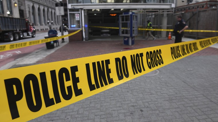 Police tape partially blocks the entrance to the Baltimore Metro Subway.