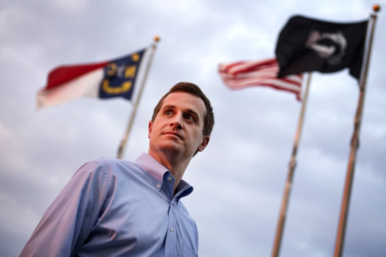 Image: Dan McCready, a Democratic candidate for North Carolina's 9th District, talks with voters in Pembroke on Aug. 10, 2019.