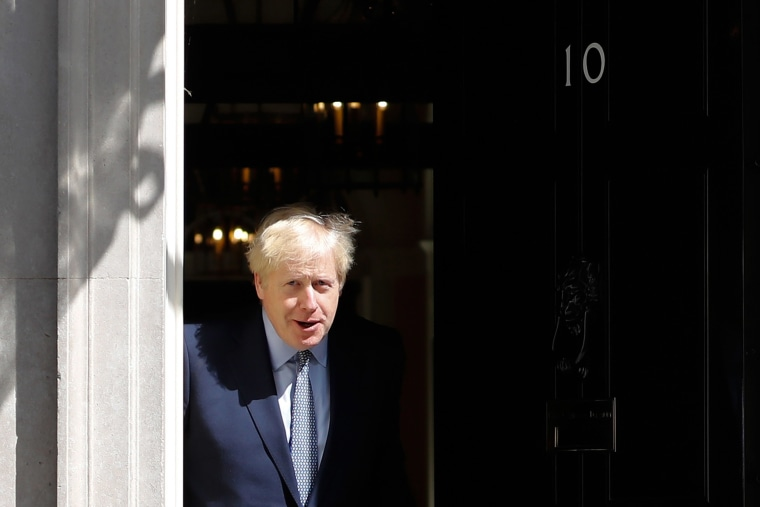 Image: Britain's Prime Minister Boris Johnson steps out of 10 Downing Street in central London.