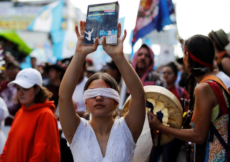 Demonstrators take part in a march to protest against the decision of Guatemala President Jimmy Morales to end the mandate of the U.N.-backed anti-graft commission (CICIG), in Guatemala City