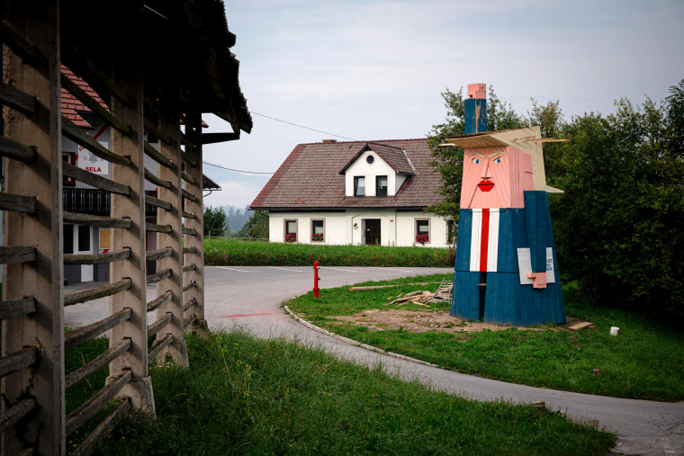 Image: A wooden structure resembling President Donald Trump in the village of Sela pri Kamniku, Slovenia, on Aug. 29, 2019. The statue, designed by local artist Tomaz Schlegl, stands nearly 26 feet tall.