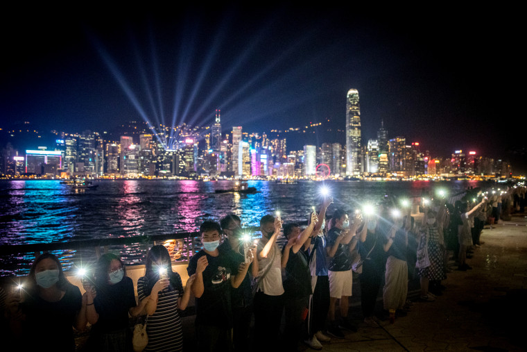 Image: Protesters hold hands to form a human chain along Hong Kong's Avenue of Stars on Aug. 23, 2019.