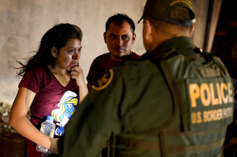 Image: Joseline, a 13-year-old migrant from Guatemala, and her father, Jose Luis, turn themselves in to Border Patrol after crossing the Rio Grande in Hidalgo, Texas, on Aug. 23, 2019.