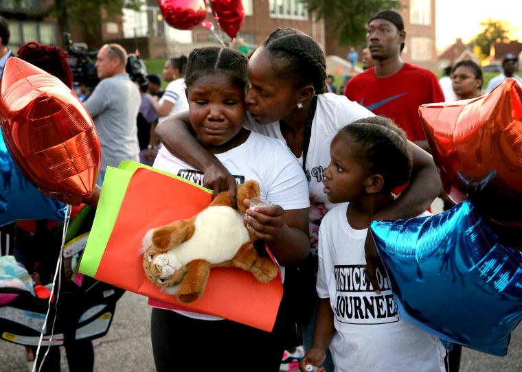 Image: Shardae Edmondson, 11, is consoled by her mother, Sharonda Edmondson, and sister Zha'lea Thompson, 7, during a vigil for murdered children in St. Louis held at Herzog Elementary School in the city Aug. 28, 2019. Shardae's and Zha'lea's sister Jurne