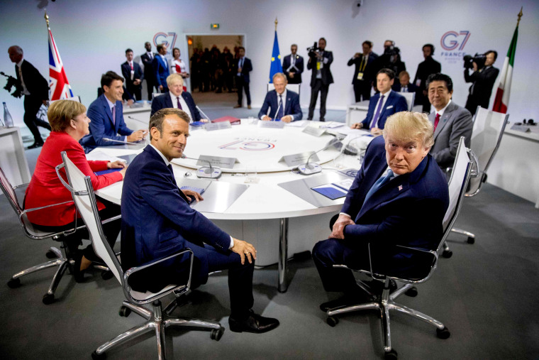 Image: French President Emmanuel Macron and President Donald Trump meet with other world leaders during a working session at the G7 Summit in Biarritz, France, on Aug. 25, 2019.