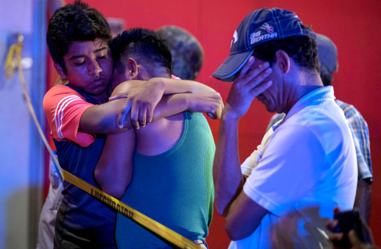 Image: Mourners hug after 23 people were killed in a fire at the Caballo Blanco bar in Coatzacoalcos, Mexico, on Aug. 28, 2019.