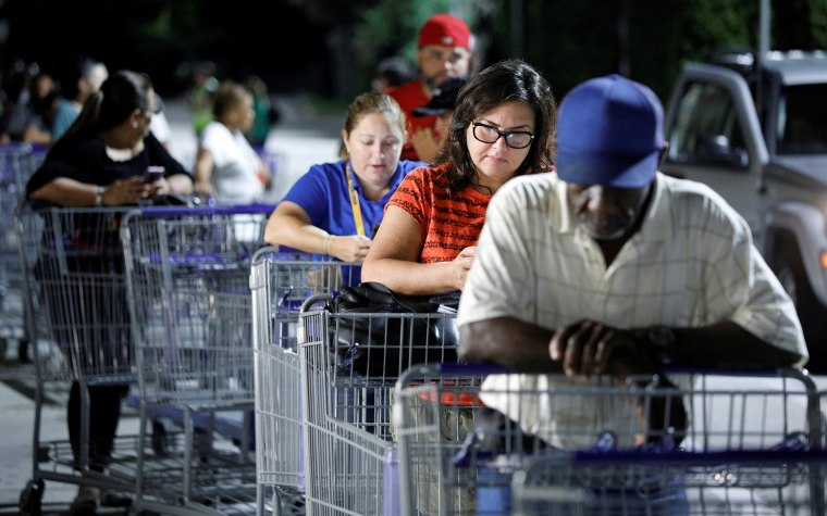 Image: Shoppers wait in line for supplies before sunrise ahead of the arrival of Hurricane Dorian in Kissimmee